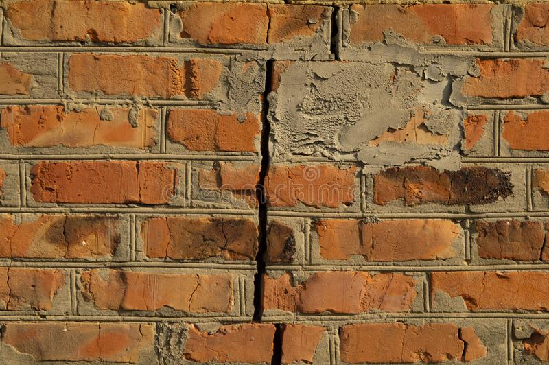 Texture - brick wall with a crack red. Old stock image