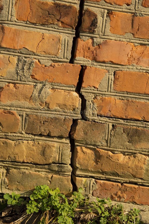 Texture - brick wall with a crack red. Old stock photography