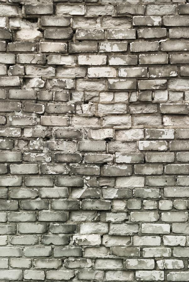 Texture of aged brick wall with cracked weathered structure white gray color close-up stock image