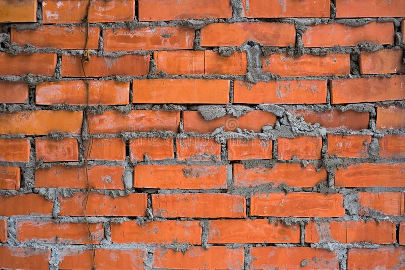 Texture of a brick wall with a loach. Texture of a brick wall and a loach stock photo