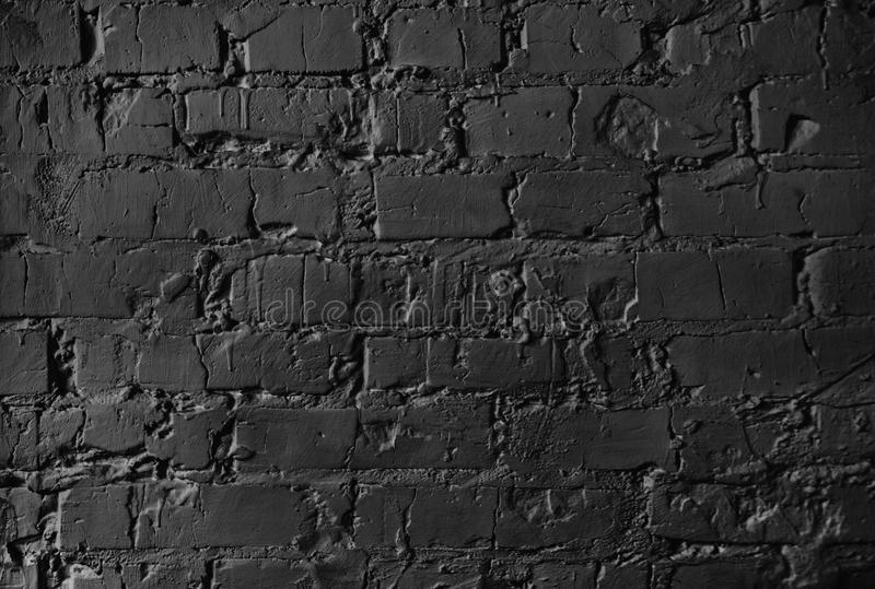 Texture of a brick wall. brickwork with cement seams of black color stock photography