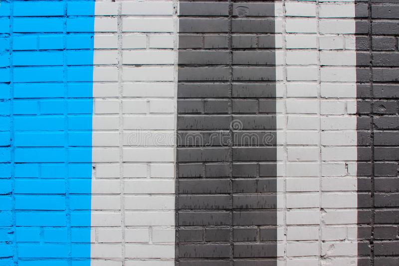 Texture of brick wall, painting of building in stripes stock photo