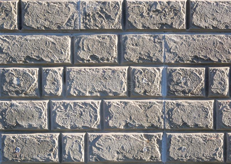 Texture of the brick wall under the cement close-up stock images