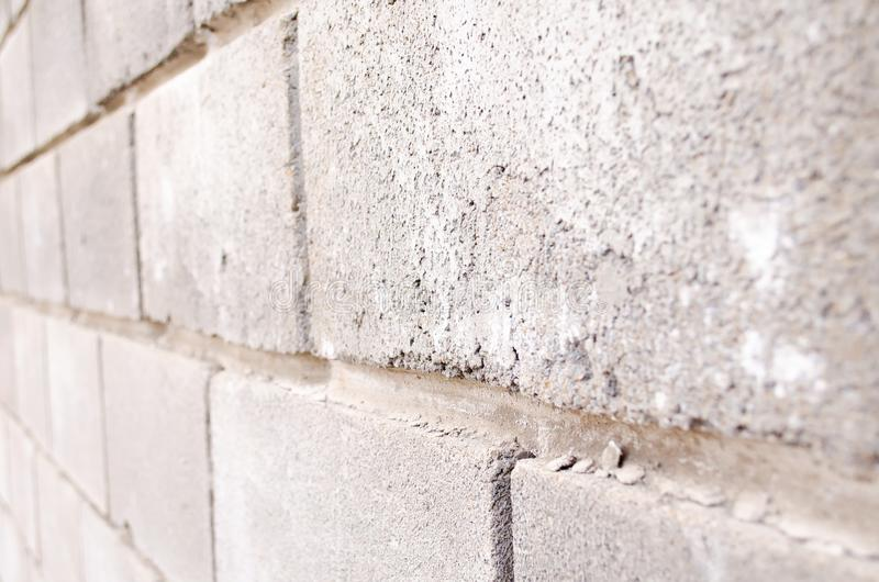 The texture of the bricks. Brick background. Background of bricks. Gray bricks. Concrete blocks. Part of the concrete wall. Gray royalty free stock photos