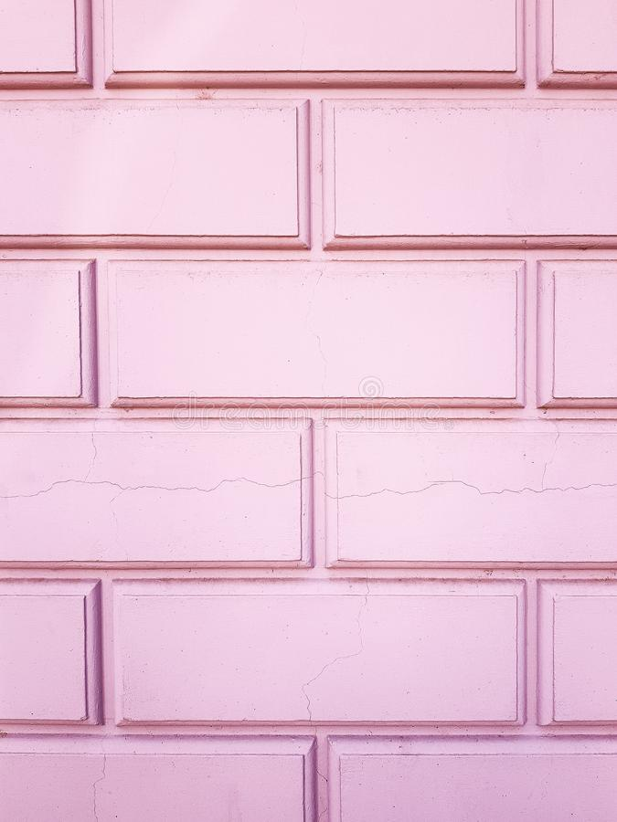 The texture of the bricks. Brick wall pink.  Old brick wall made of pink  color. royalty free stock images