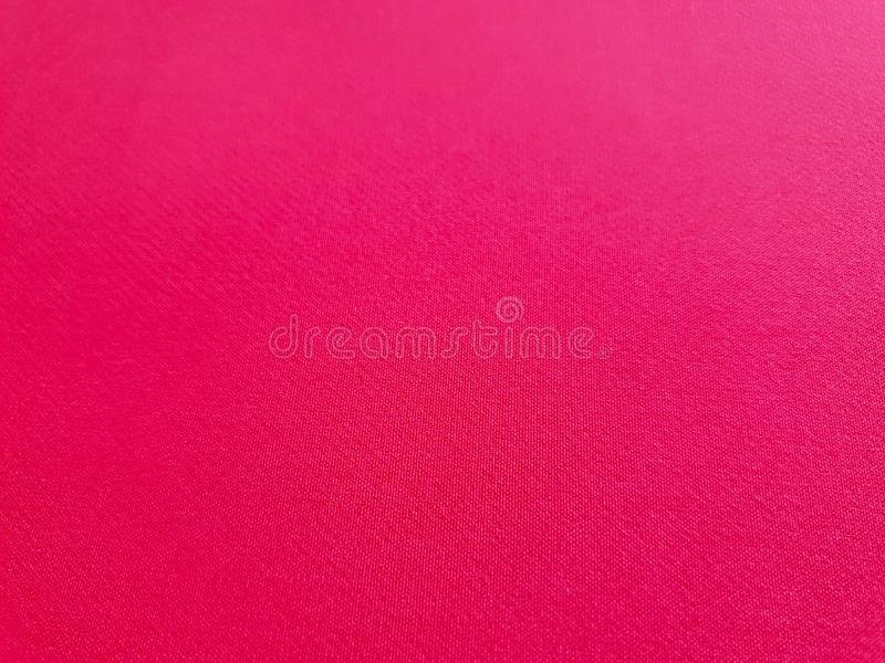 Texture brillante, fond de corail plat, modèle de tissu Tissu de corail vif et riche, tissu lourd sur un fond blanc, papier peint photographie stock libre de droits