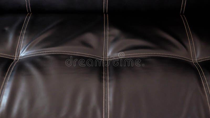 texture brillante piquée en cuir de noir de place photos stock