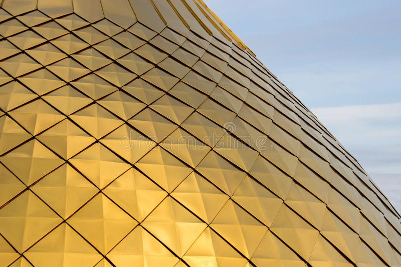 The texture of the brilliant golden dome with rhombus patterns. On blue sky, close-up royalty free stock images