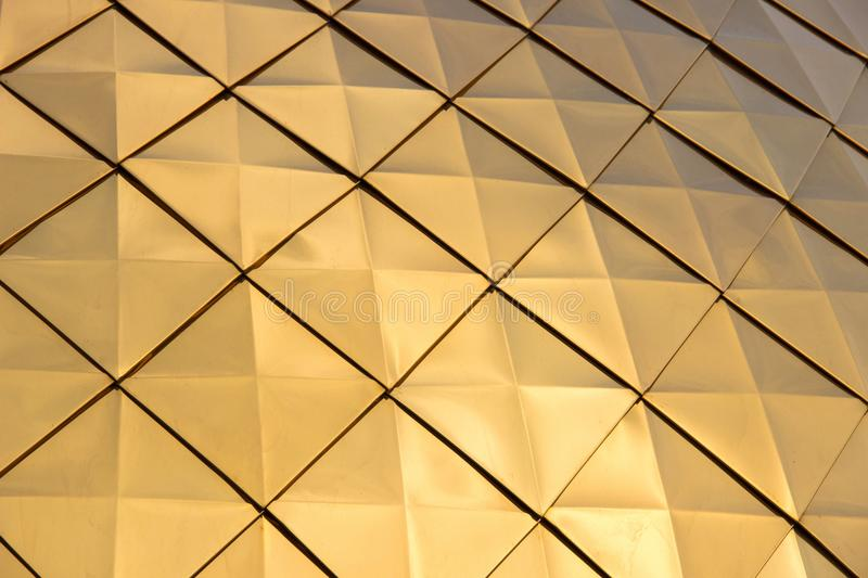 The texture of the brilliant golden dome with rhombus patterns,. Close-up royalty free stock images