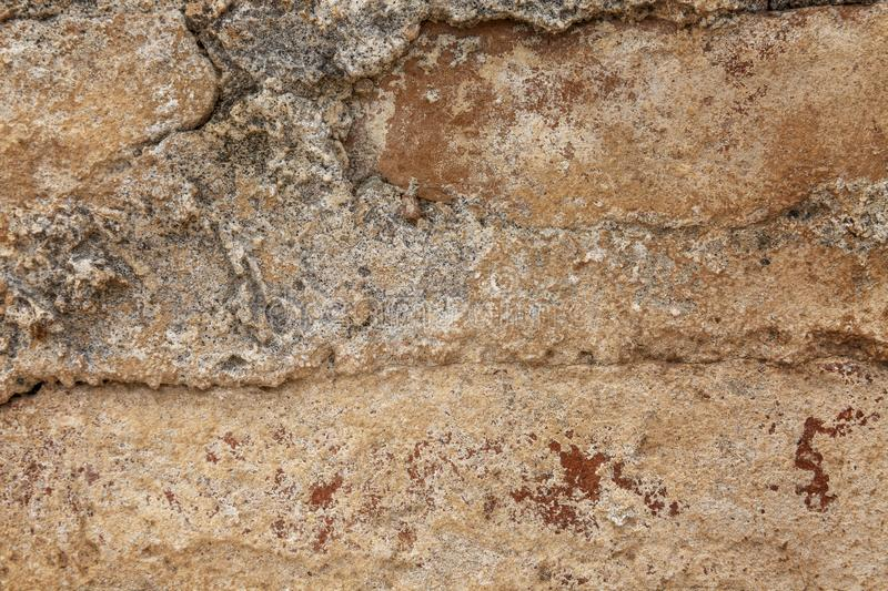 Texture of a brown bricked-up wall. Space for text. Background. Horizontal royalty free stock image