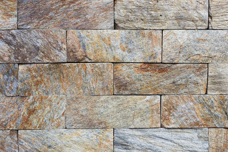 Texture of the brown and grey wall made of stone tile bricks.  stock photography