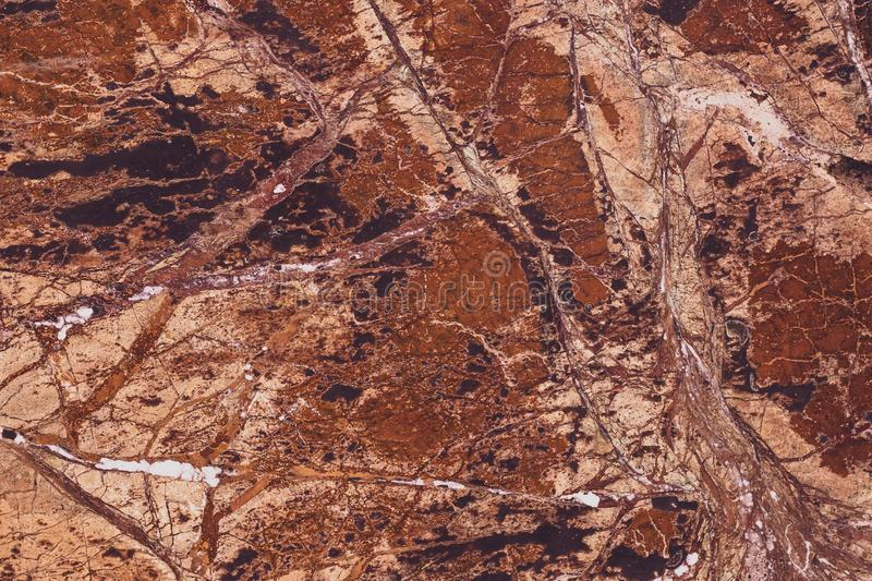 Texture of brown marble, colorful stone background. Grunge rock wall. Abstract natural modern pattern for design. Granite slab sur royalty free stock photography