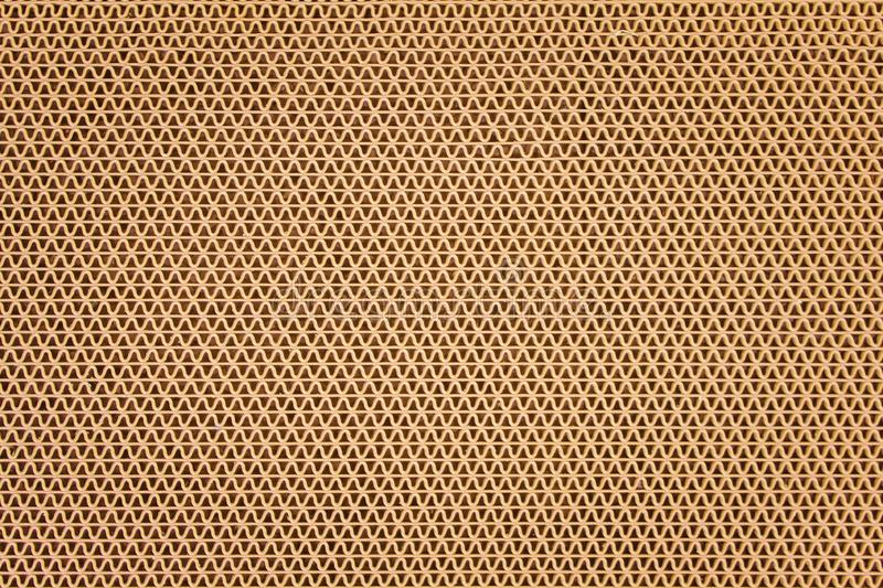 Texture brown plastic rubber doormat in ripple shape patterns on background stock images