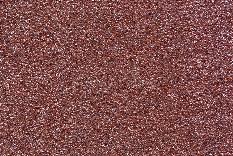 Texture of brown water-resistant sandpaper macro stock photo