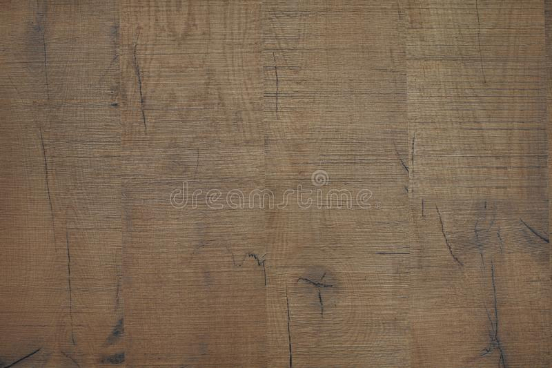 Texture of brown wood. Rough planks with cracks and knots. Texture of brown wood. Rough planks royalty free stock image