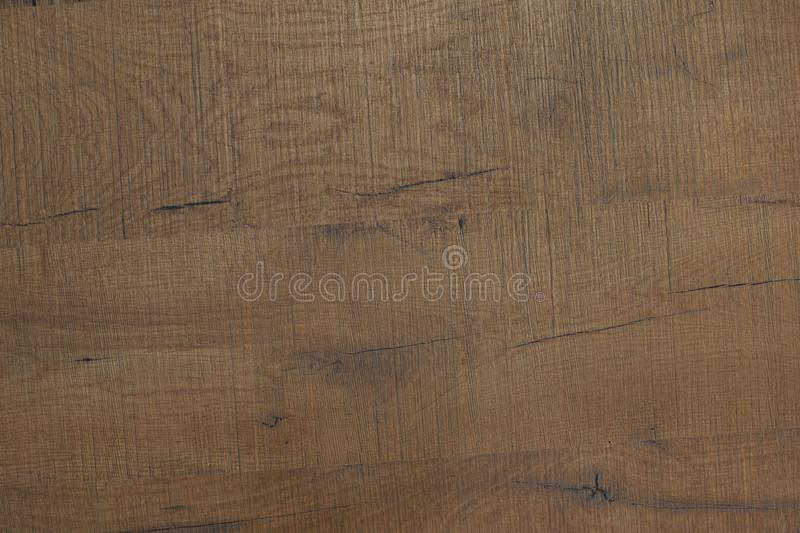 Texture of brown wood. Rough planks with cracks and knots. Texture of brown wood. Rough planks stock images
