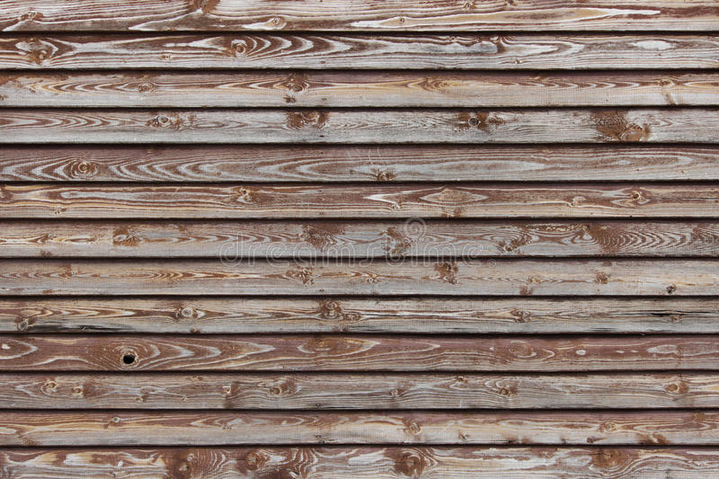 Texture of a brown wooden fence of plaques covered with paint. Texture of a brown wooden fence of plaques covered with paint royalty free stock photos