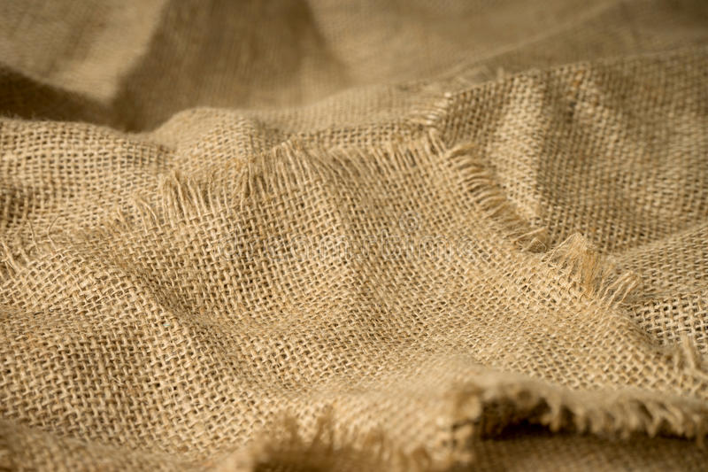 Texture of burlap material background hessian. With frayed edges royalty free stock image