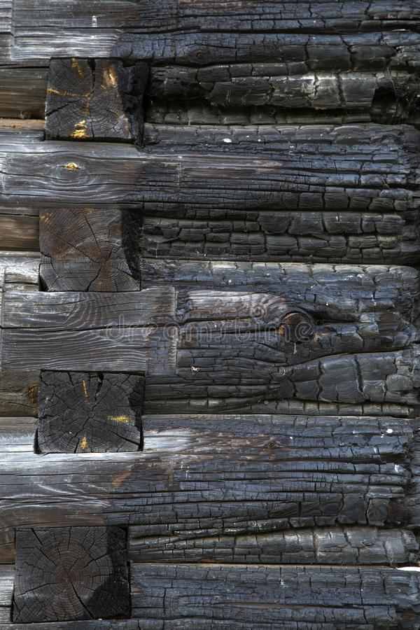Texture of a burned wooden wall stock photo