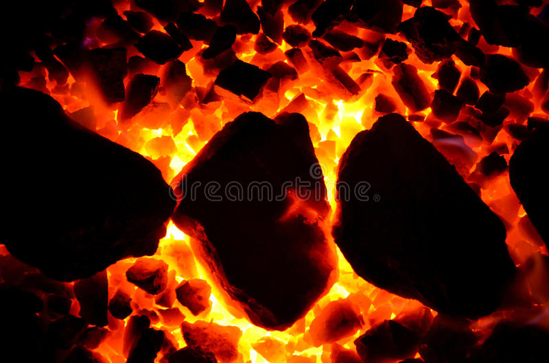 Texture of burning coal. The background of the burning coal is a fine fraction and laid exactly large royalty free stock image