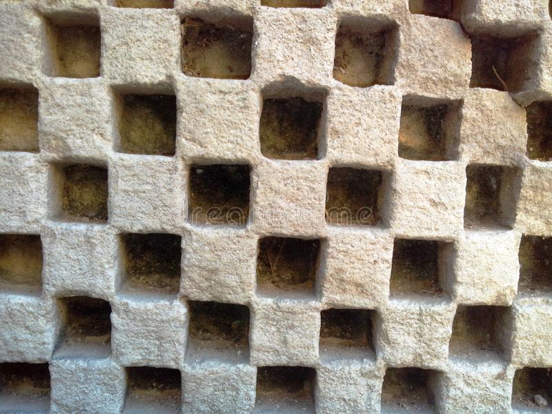 Texture carving square design ancient. Carving in a ancient vav in a square design stock image