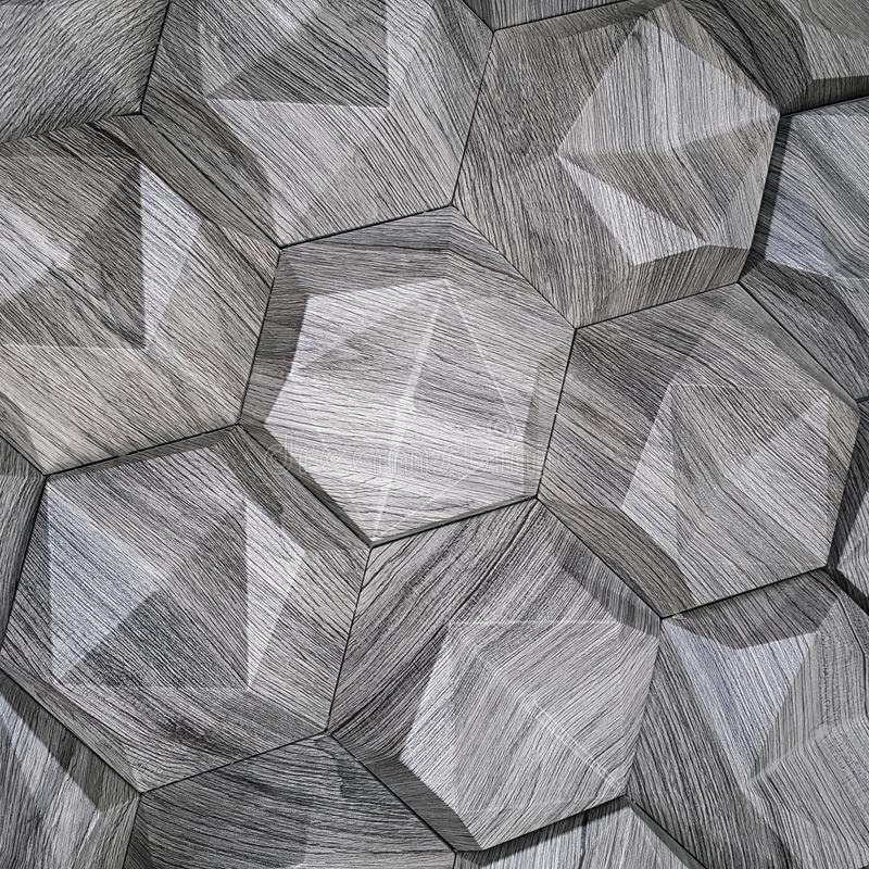 The texture of the ceramic tiles in the form of a hexagon made of natural stone of gray color with convex surfaces of a triangular royalty free stock photography