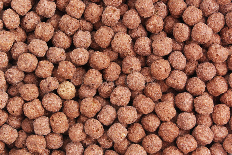 Texture of chocolate corn flakes. Element of design royalty free stock images