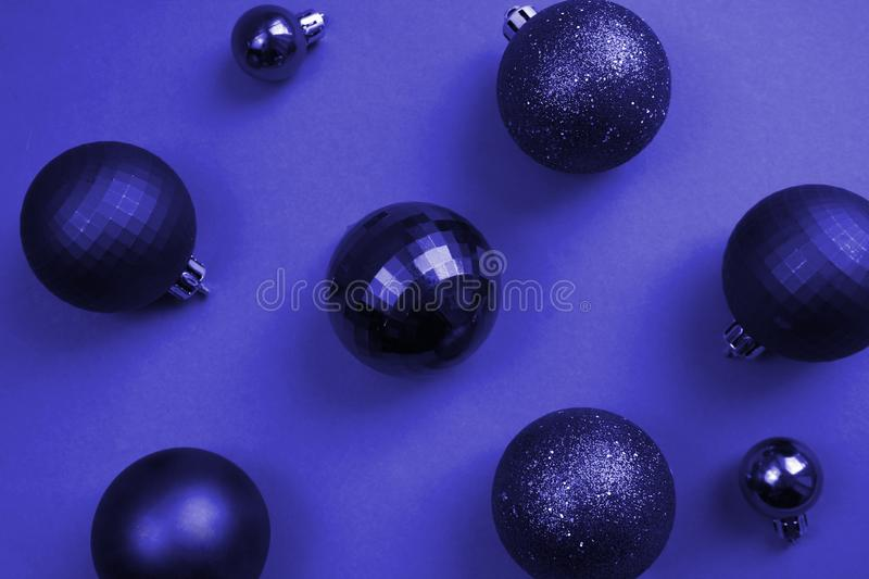 Texture christmas balls in blue on a blue background stock photography