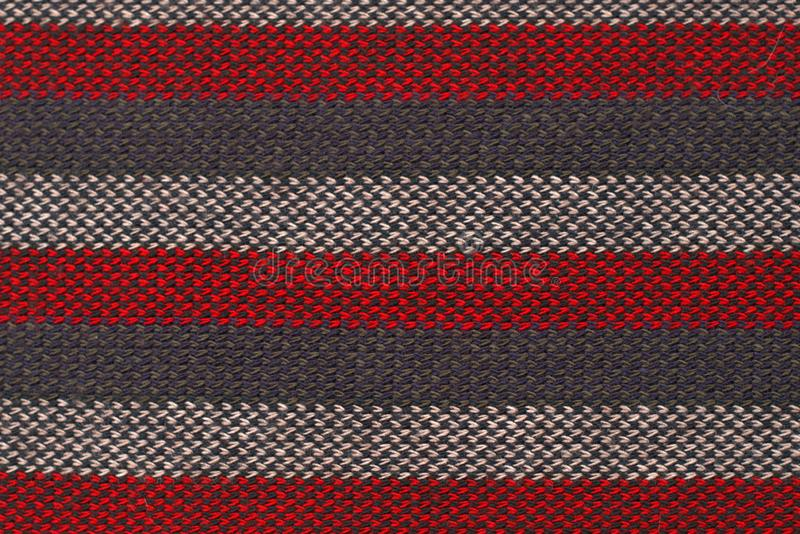 Texture close up of a red, gray and white striped wool cloth royalty free stock images