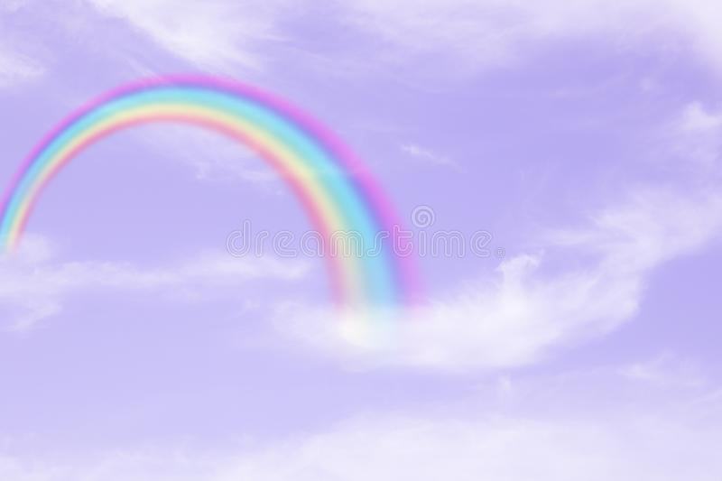 Rainbow in cloudy sky royalty free stock photo