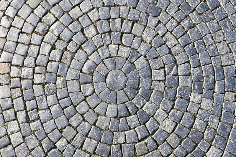 Texture of cobblestone in old town. royalty free stock photography