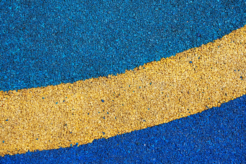Texture of color rubber floor on playground royalty free stock photo