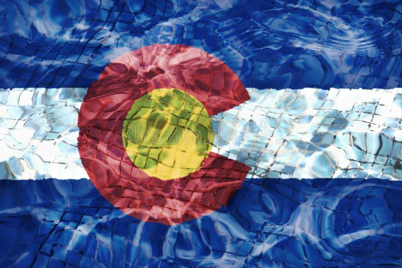 Texture of Colorado flag in the pool, water. royalty free stock image