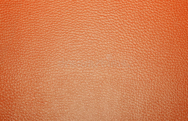 Texture colored leatherette , for design and upholstery for dec. Texture colored leatherette brown, for design and upholstery for decoration and fashion, for the royalty free stock photography