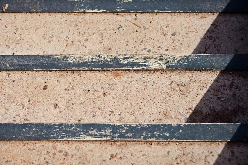 Texture of a concrete staircase with metal corners from above in bright sunlight. Is close royalty free stock images