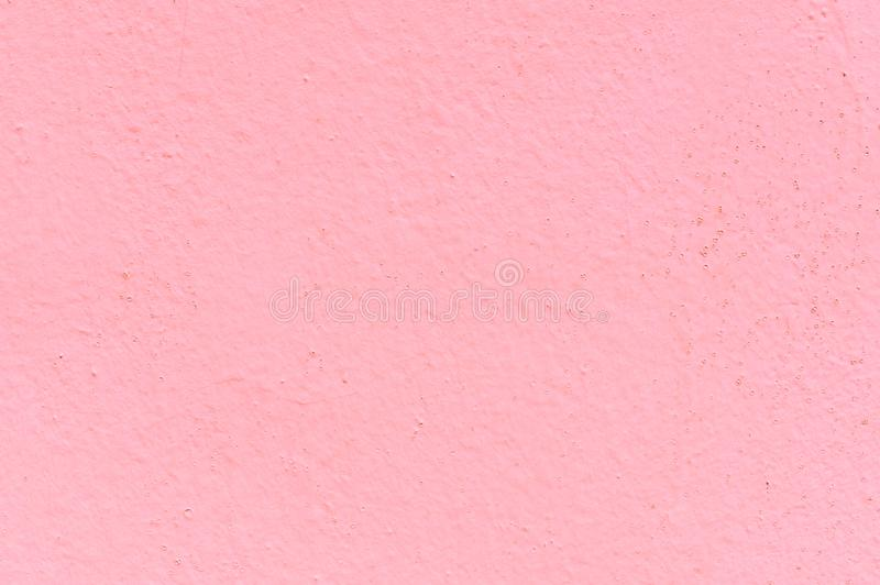 The texture of the concrete wall is covered with pink oil paint. Great background for any use stock photos