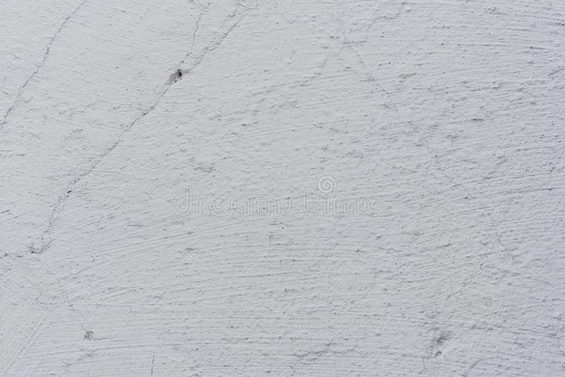 Texture of a concrete wall with cracks and scratches which can be used as a background stock images