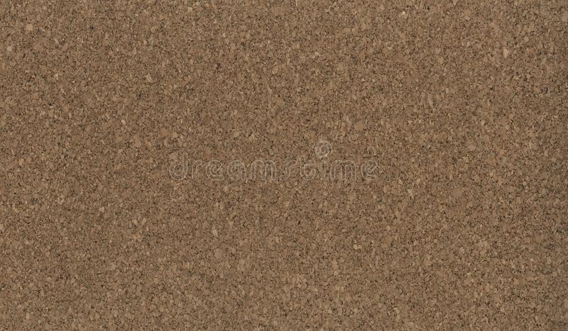 Texture cork wood - chips in the slice. A macro of a coaster. Yellow Cork board texture background. Blank cork board with wooden. ellow Cork board texture royalty free stock images