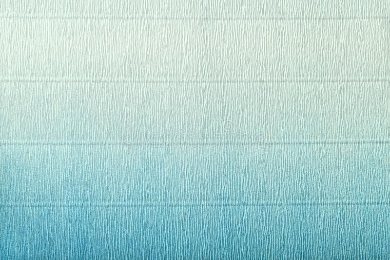 Texture of corrugated light blue and turquoise paper with gradient royalty free stock photography