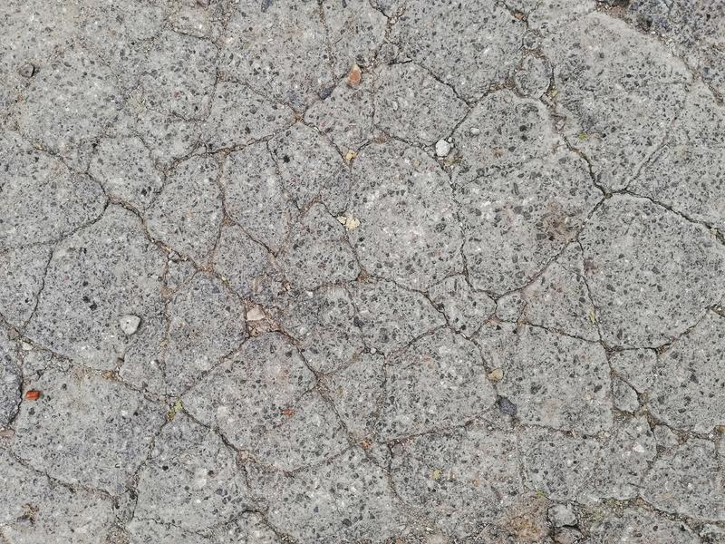 Texture of cracked asphalt. Texture of old gray cracked rough asphalt royalty free stock image