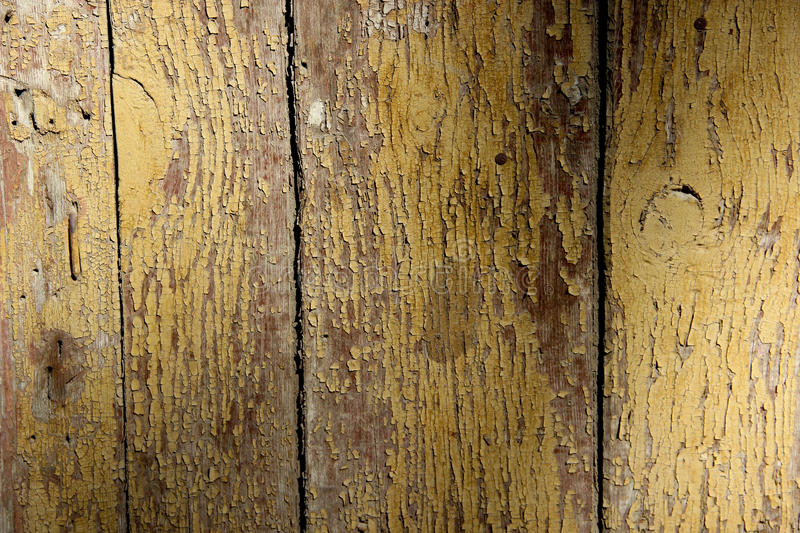 Texture of cracked wooden panels covered with peeled paint royalty free stock photo