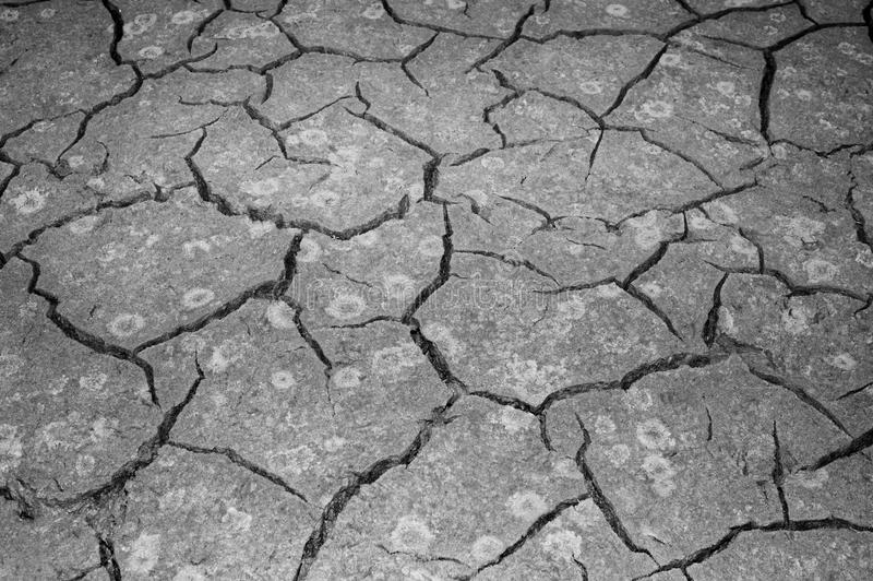 The texture of the cracking of the earth. The concept of using natural resources. Black and white image stock photography
