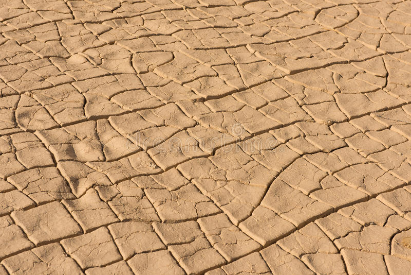 Texture of crackled red clay in desert stock photos