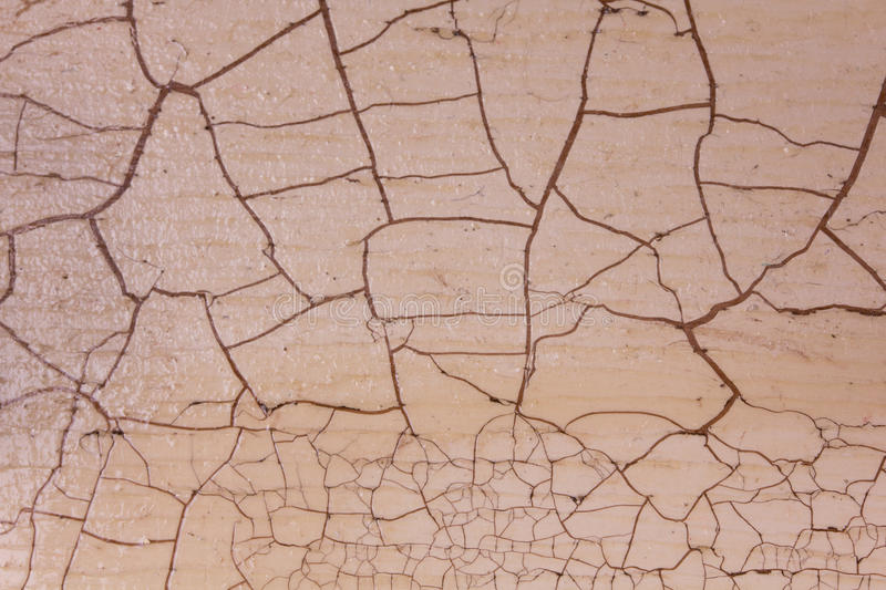 Texture with craquelure. Wooden board with craquelure, beige and brown stock photography