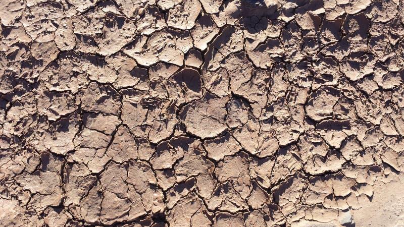 Texture criquée sèche de la terre pour des jeux vidéo image libre de droits