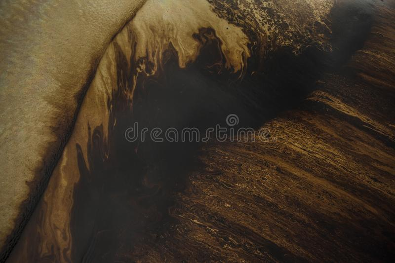 Oil spill on beach royalty free stock images