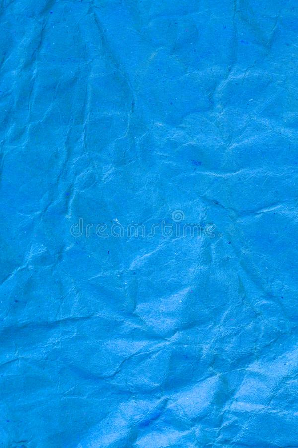 Texture crumpled blue paper background. Abstract, aged, ancient, backdrop, blank, brown, card, cardboard, color, crease, creased, damaged, design, detail stock images