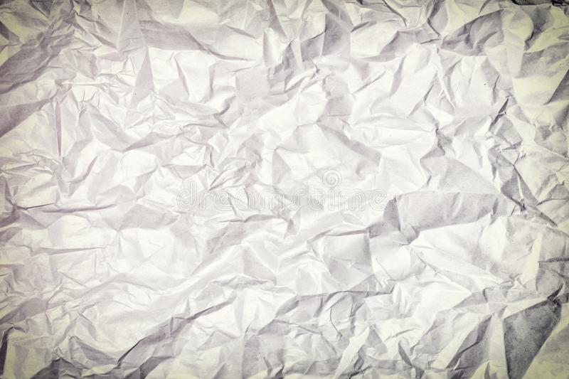 Texture of crumpled paper, background. Photo with vignette. royalty free stock photography