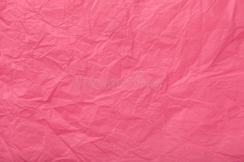 Texture of crumpled pink wrapping paper, closeup. Purple old red background stock photography