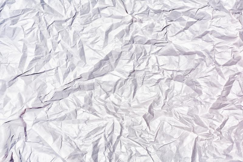 Texture of crumpled white paper close up. Blank abstract background. stock photo